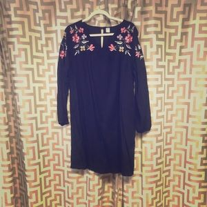 Black long sleeve dress with flowers.